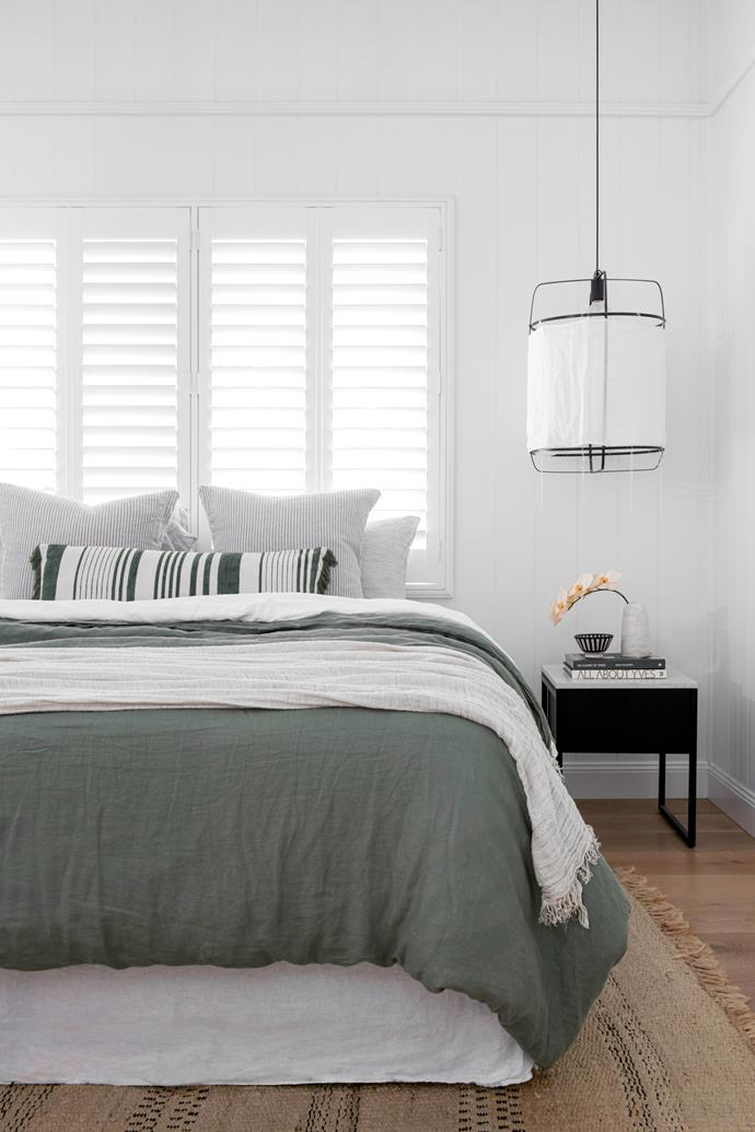 """**MAIN BEDROOM** """"I had a linen headboard, but it was too high for that spot. The bed looks much nicer with just the shutters behind it,"""" says Jordan. Bedspread, [Adairs](https://www.adairs.com.au/