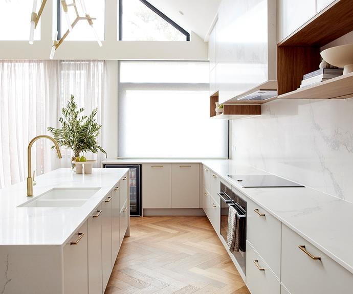 Herringbone floors ground the light and bright space.