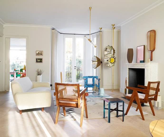 In her light-filled home in London's West End, Nathalie Assi has successfully intertwined her personal and work lives. The sitting room doubles as a showroom filled with contemporary designs for sale. The Daffodil lights, made from bevelled mirrors, are by Pietro Russo, and Marc Dibeh designed the (Not So) Gloriole floor lamp. The blue aluminium chair from Soft Baroque acts in stark contrast to the vintage Compass timber chairs by Pierre Jeanneret; Danish artist Jesper Skov Madsen created the pink artwork on the mantelpiece.
