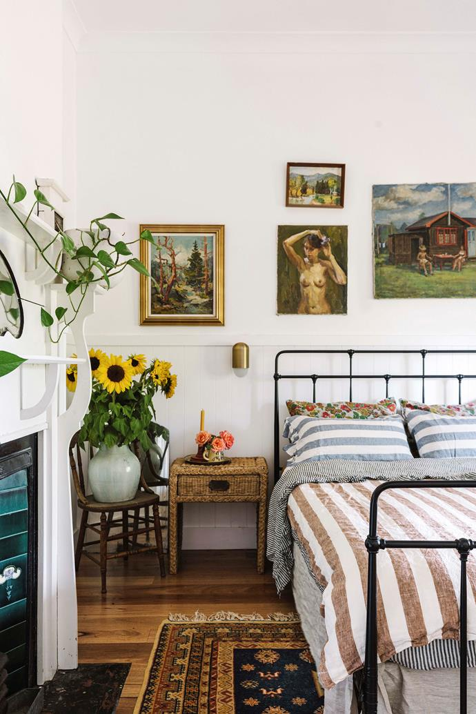 Emma and Matt's bedroom features an original fireplace.