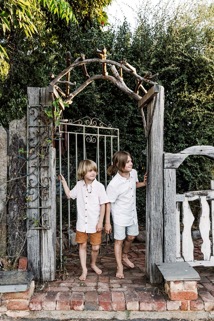 Abel and Reggie at the gate to the home. Matt, a keen gardener, created the fence from recycled timber.