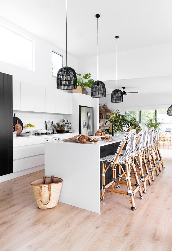 """The heart of the home scored the biggest transformation. """"It's a social place where the girls and I cook and chat, so I wanted it to feel welcoming yet also incredibly functional,"""" says Amber. Finishes include Technistone Noble Supreme White benchtops and custom two-pac cabinetry in [Dulux Lexicon Quarter](https://www.homestolove.com.au/dulux-white-paint-colours-5396