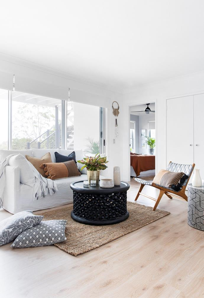 """The downstairs [living area](https://www.homestolove.com.au/modern-living-room-ideas-18535