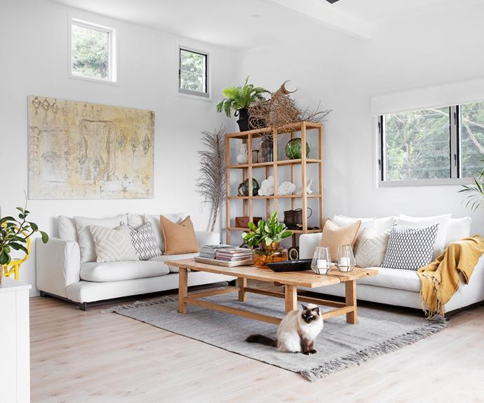 The living area features 'EasyTime' sofas from Camerich, a CLO Studios coffee table, a Kathy Brauer artwork and Lila the cat.