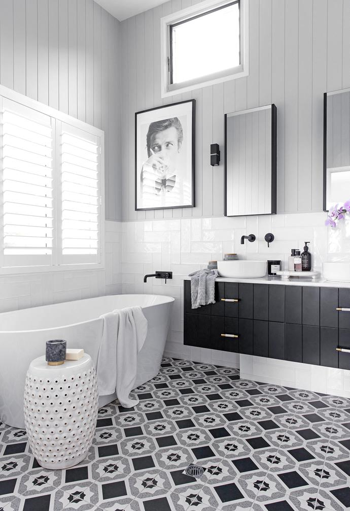The old ensuite was beige and apricot and featured an oversized corner spa bath. The new pamper zone in striking black, grey and white is memorable for all the right reasons. Wall and floor tiles from Amber Tiles lay the foundation for the palette, with the tones picked up in VJ walls painted in Dulux Tranquil Retreat, custom vanity drawer fronts in Dulux Domino and black tapware from Highgrove Bathrooms, also the source of the freestanding bath and 'Eden' basins, while the mirrors were custom made.