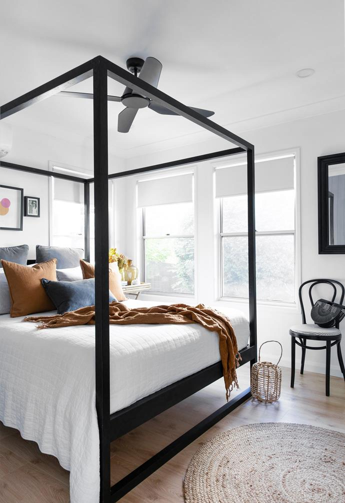 Visiting friends and family enjoy hotel-like luxury, with a four-poster timber bed from CLO Studios dressed in linen from Pillow Talk and Adairs. Amber has had the framed Rachel Castle print above the bed and bentwood chair from Thonet for years.