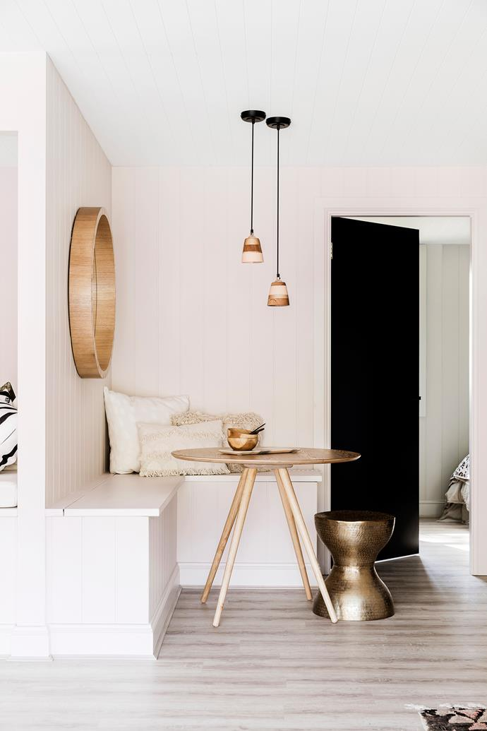 """In this [space-challenged holiday home by Three Birds Renovations](https://www.homestolove.com.au/three-birds-caravan-and-river-shack-renovation-5565 target=""""_blank""""), bench seats that create a small breakfast nook offer storage and maximise the space at hand. A round dining table is a smart choice for small spaces like this."""