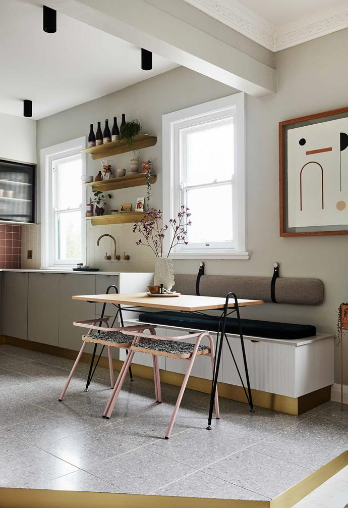 """Interior architect Sophie Bower has incorporated some genius space-saving ideas into her [small Sydney apartment](https://www.homestolove.com.au/small-apartment-design-ideas-20593 target=""""_blank""""), like this stylish breakfast """"eating nook"""" off the kitchen. The custom banquette seating paired with slimline furniture provides enough seating for four — and there's storage underneath."""