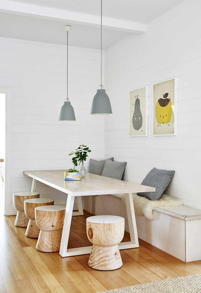 """The casual breakfast nook in the kitchen of this [Barwon Heads beach house](https://www.homestolove.com.au/californian-bungalow-barwon-heads-17909 target=""""_blank"""") features a custom bench seat crafted by builder Mark Mulheron, as well as a table and 'Eggcup' stools from Mark Tuckey."""