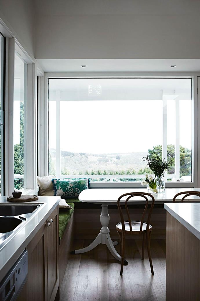 """Views from the breakfast nook in this [light-filled farmhouse on the Mornington Peninsula](https://www.homestolove.com.au/a-light-filled-farmhouse-on-the-mornington-peninsula-13833 target=""""_blank"""") look out over Greens Bush Reserve towards the sea."""