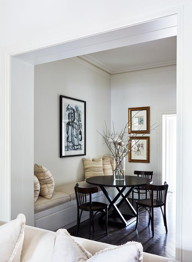 """Thonet chairs and a painting by Olivier Rasir add a contemporary touch to the dining nook in this [19th century updated Sydney apartment](https://www.homestolove.com.au/a-19th-century-pied-a-terre-in-sydney-4928 target=""""_blank"""")."""