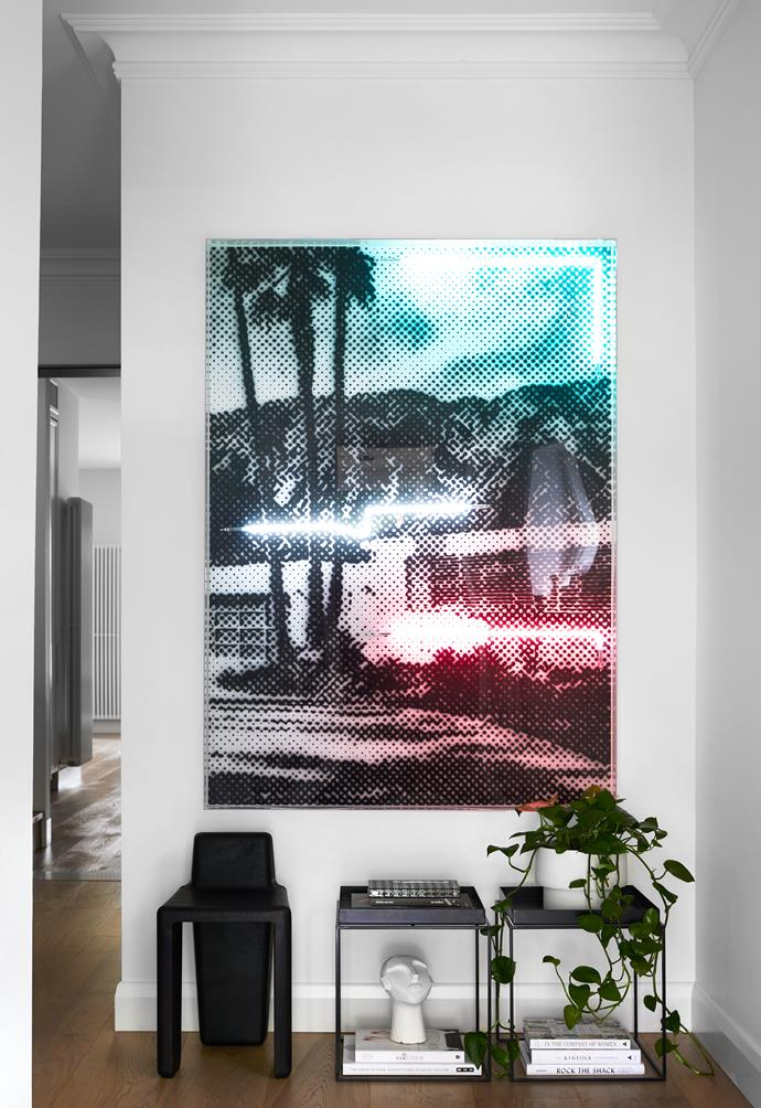 """In a corner of the living room space is this lively print by [Tom Adair](https://www.tomadair.com.au/artworks