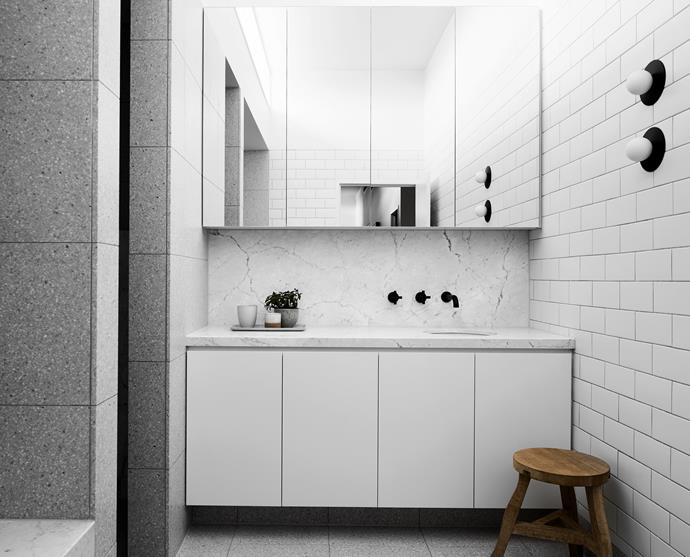 **FAMILY BATHROOM** A Tom Dixon stool provides a handy perch in this white wet area.
