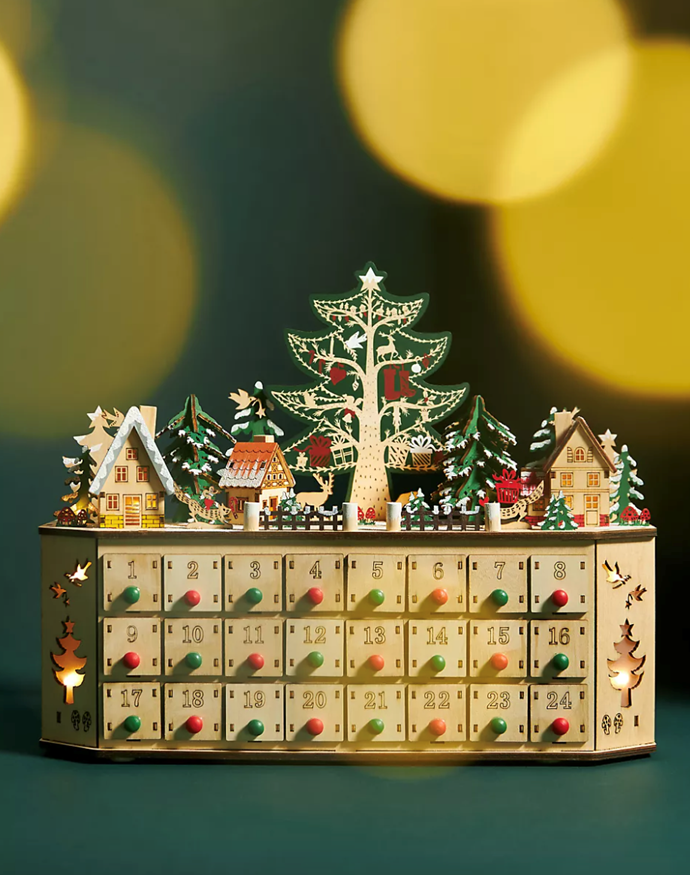 """**Annie Howe Tannenbaum Light-Up Advent Calendar$88, [Anthropologie](https://www.anthropologie.com/shop/annie-howe-tannenbaum-light-up-advent-calendar?category=SEARCHRESULTS&color=000&searchparams=q%3Dadvent%2520calendar&type=STANDARD&size=One%20Size&quantity=1