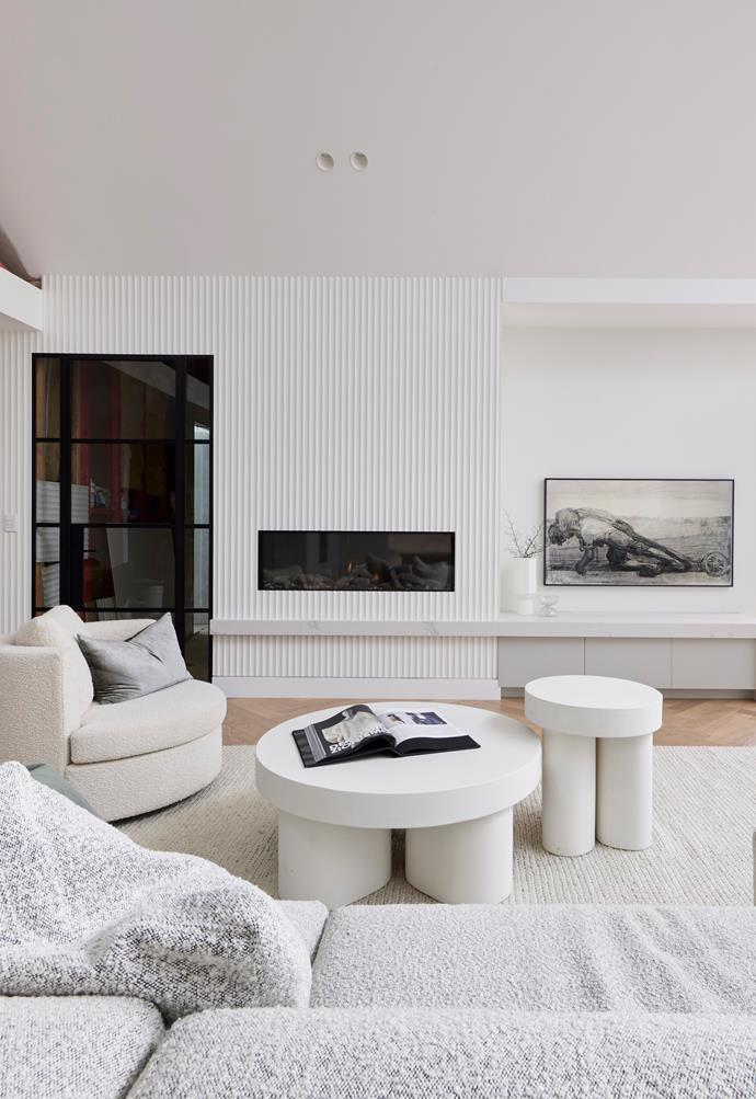 """Along one panelled wall is a contemporary [fireplace](https://www.stokefires.com/au/