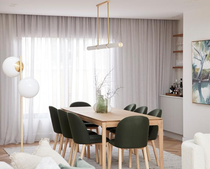 """Olive green in the artwork and objects play off brass accents in [lighting](https://www.beaconlighting.com.au/made-by-mayfair-luella-led-1500mm-pendant-in-brass-alabaster