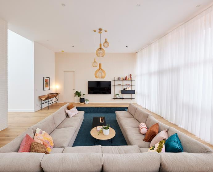"""Neale said there is nothing more conducive to people being together than a sunken lounge room, whilst Darren found the coloured carpet """"joyful"""" and admired the retro open joinery on the wall."""