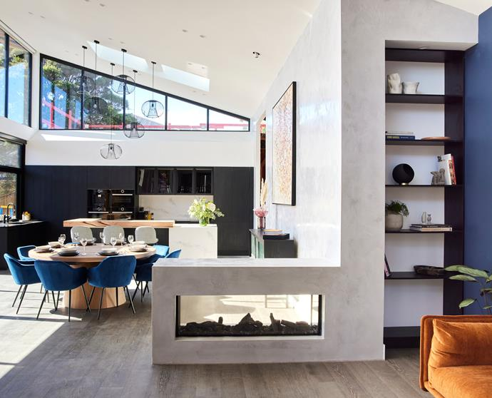 The open floor plan featured a Venetian plastered wall running along from the kitchen area to wrap around a double-sided fireplace.
