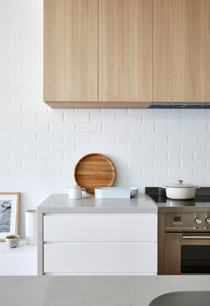 **KITCHEN** On the wall side of the island, the bench drops down to the living area's cabinetry, marking the change in zone.