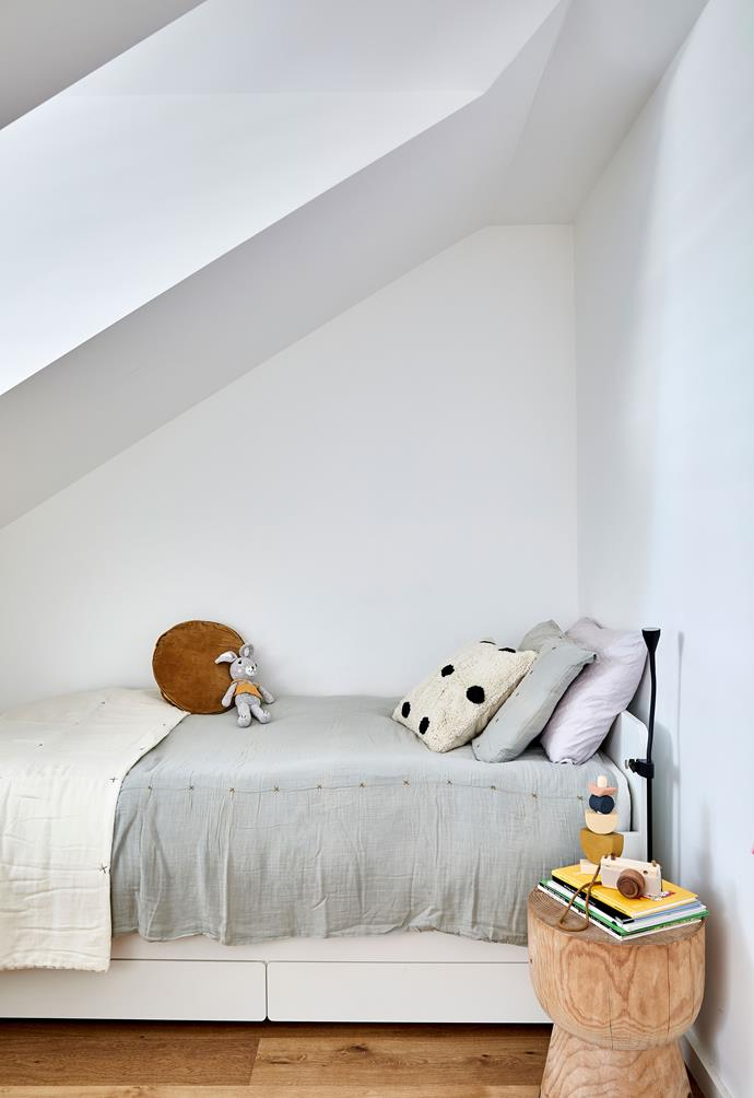"""**BEDROOM** Brooklyn's room was configured to work with the angle of the roof. Bed, Ikea. Butterscotch penny-round cushion, [Castle And Things](https://www.castleandthings.com.au/