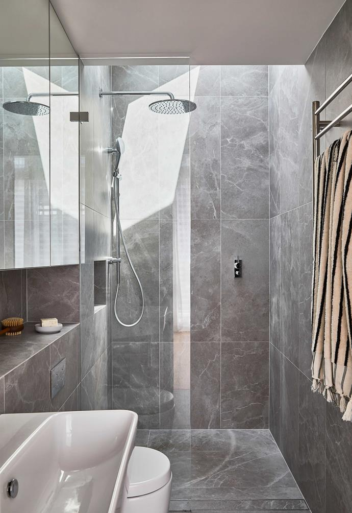 """**ENSUITE** """"We have a skylight over the shower and an LED strip under the cabinet for when there's not enough natural light,"""" Zander explains. Grey marble wall tiles, [Surface Gallery](https://surfacegallery.com.au/