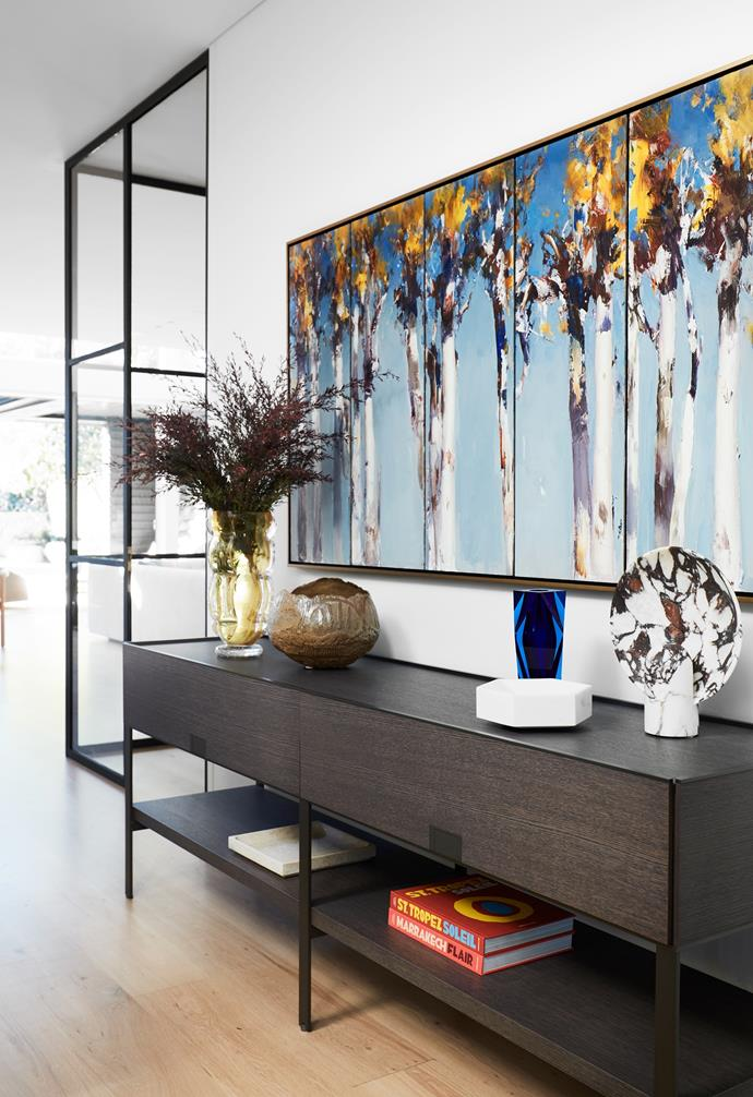 B&B Italia 'Eracle' console from Space. Murano vase from Conley & Co. Brown ceramic bowl from Rudi Rocket. Moser vase from Conley & Co. 'Surface' sconce from Studio Henry Wilson. Artwork by Ken Knight from Wentworth Galleries. The steel-framed glass doors enclose the new wine room.