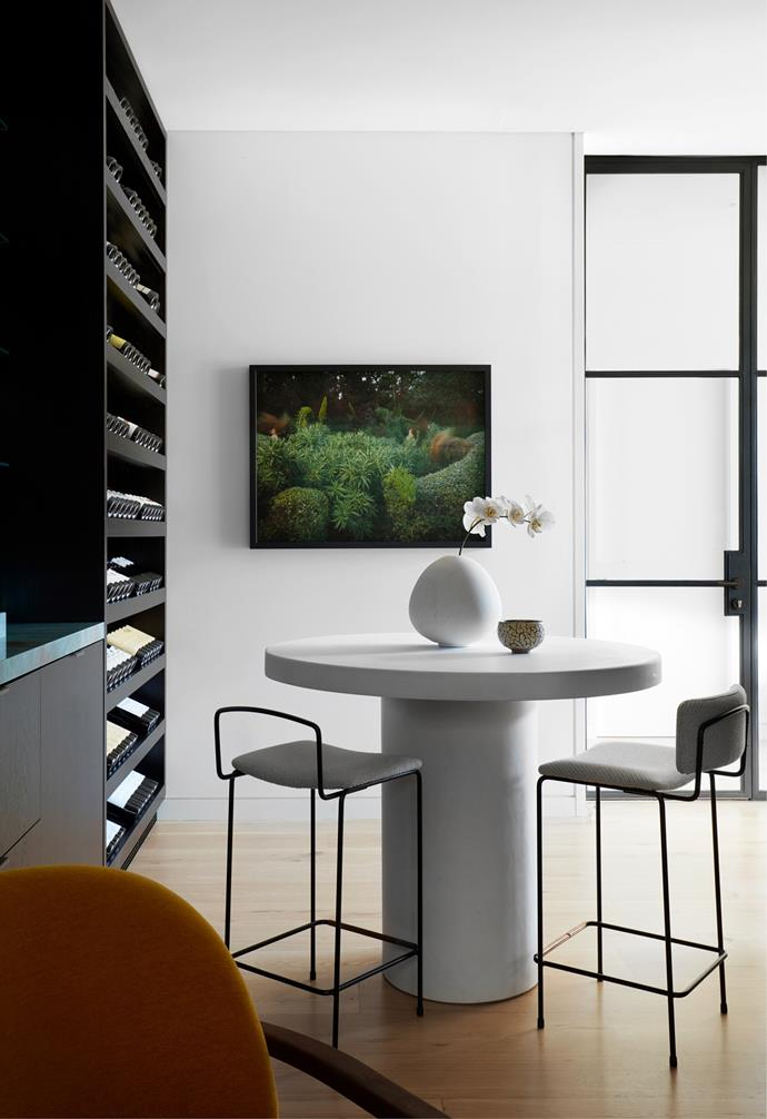 The new wine room is a favourite of the owners and the designers. Custom bar table by Hugh-Jones Mackintosh with 'Iva' stools from Grazia&Co. Michaël Verheyden 'Kando' vase from Ondene. Artwork, Pride of Madeira (Echium candican) in Spring 2017, by Tamara Dean from Michael Reid Sydney.
