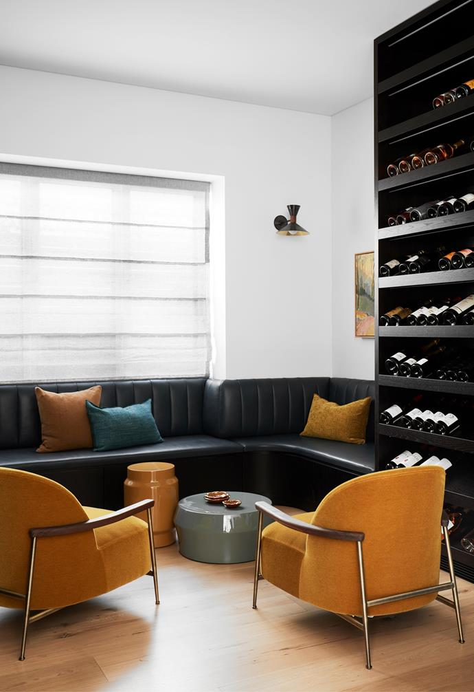 Custom curved leather banquette seat by Hugh-Jones Mackintosh. Cushions from Tigger Hall Design. Gubi 'Sejour' armchairs from Criteria. Blind by Simple Studio.