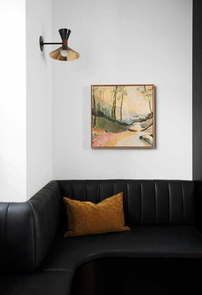 An artwork by Meg Walters from Michael Reid Sydney is displayed above the custom leather banquette seat.