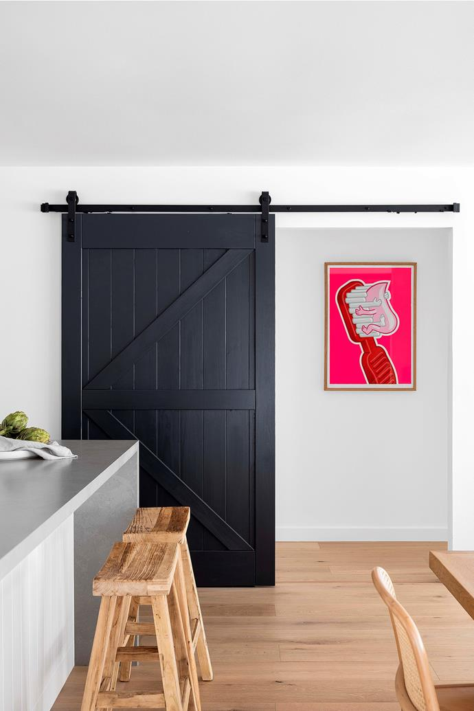 """""""The barn door closes off the corridor that leads to the bedrooms so sleeping children won't be disturbed by adults having a late night,"""" says Mariela."""