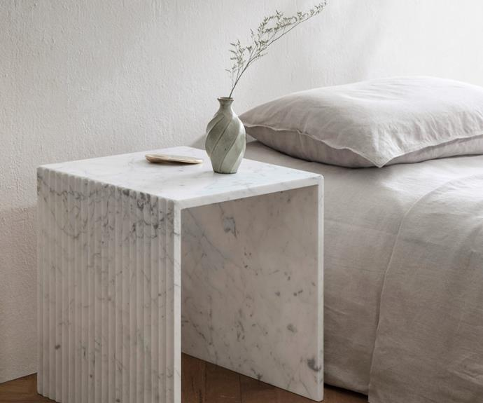 """Natural stone, soft curves and linear details combine in the 'Ida' Fluted Side Table from [Chelon Design](https://www.chelon.com.au/shop/p/ida-fluted-side-table-bianco-carrara