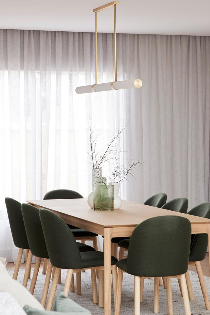 """Olive greens and generous sheer curtains grace Ronnie and Georgia's [winning dining room](https://www.homestolove.com.au/the-block-2021-living-and-dining-room-reveals-23016