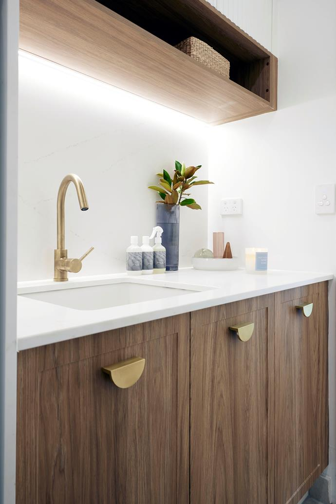Mitch and Mark's laundry cabinetry features a subtle shaker profile.