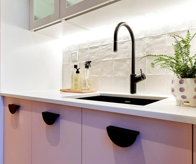 The pink cabinetry links back to the couple's mid-century inspired kitchen.