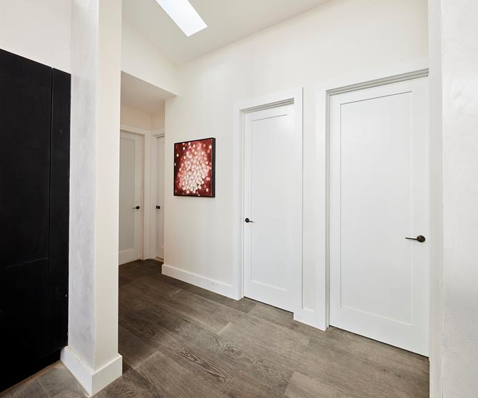 The hallway revealed, rather than concealed, the private quarters of the home.