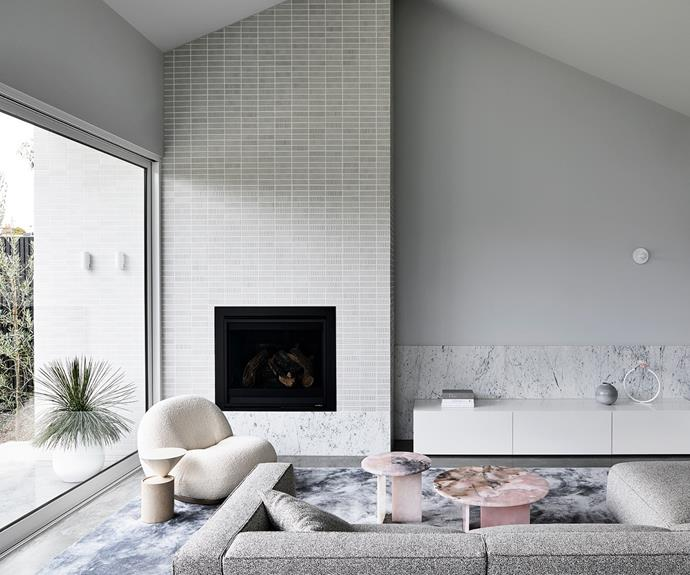 """To create a sense of cosiness in the double-height living room, [interior designer](https://www.homestolove.com.au/10-australian-interior-designers-to-follow-on-instagram-2103