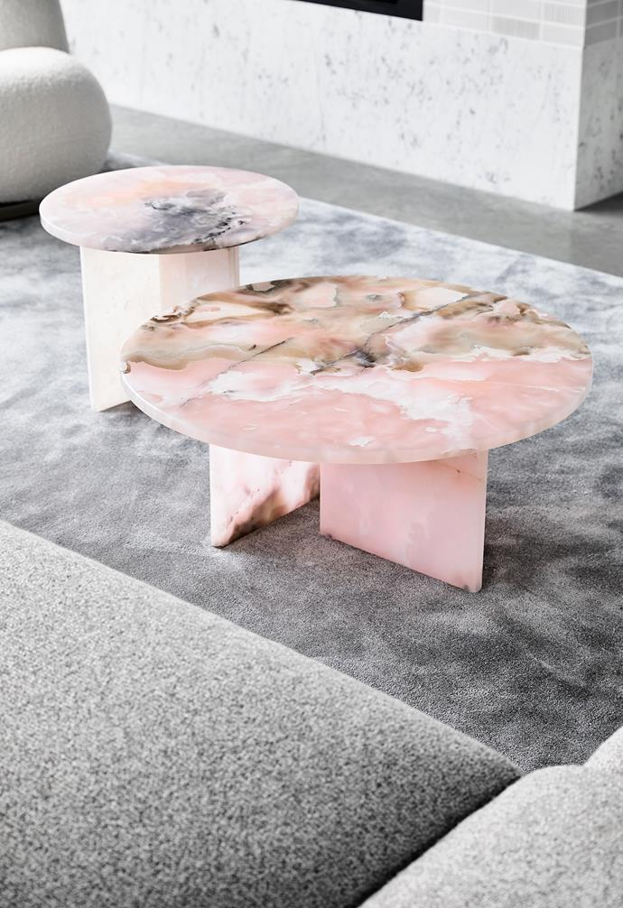 The positioning of two pink onyx coffee tables by Baxter are a playful touch,  enhancing the comforting curves in the living space.