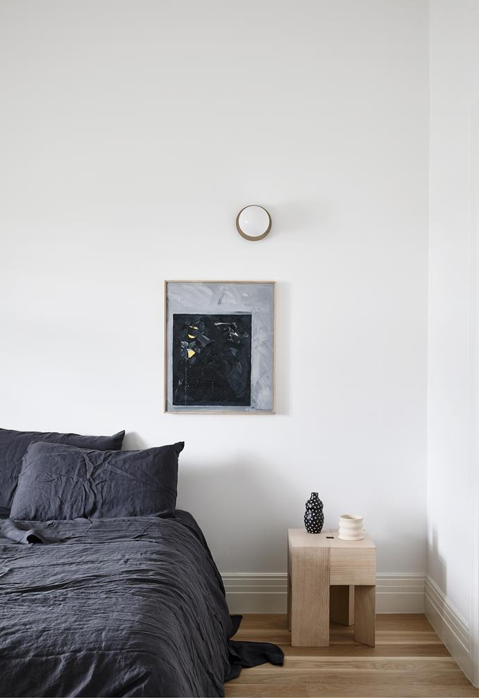 Charcoal- coloured Cultiver bedlinen creates contrast and drama in the bedroom. Engineered floorboards by Woodcut, a Karakter bedside table and Sean Bailey artwork add depth.