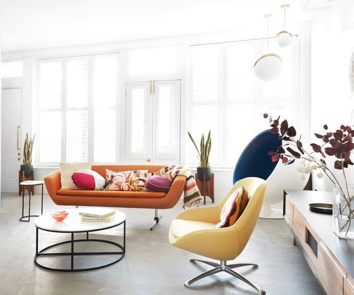"""**LIVING AREA** No need to add colour with cushions here — the yellow and orange seats do the job nicely. Armchairs, [BoConcept](https://www.boconcept.com/en-au/