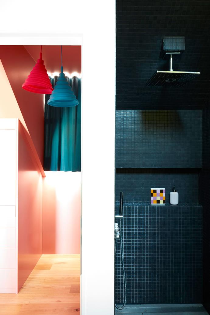 """**MAIN BEDROOM** (left) A corner of the room near the wardrobe, featuring silicone pendant lights by Denmark's [Nordlux](https://www.nordlux.com/