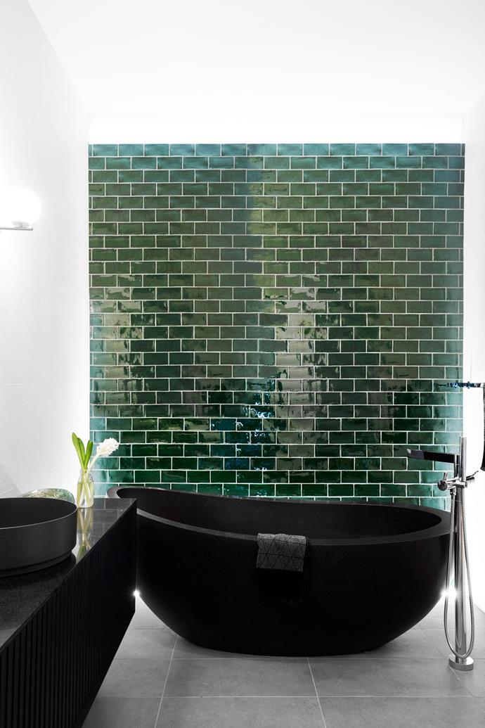 "**MAIN BATHROOM** On the first floor is a different kind of green wall: subway tiles from Bisanna. Autumn stone bath, [Pietra Bianca](https://www.pietrabianca.com.au/|target=""_blank""|rel=""nofollow""). Alape 'Unisono' counter basin, [Reece](https://www.reece.com.au/|target=""_blank""|rel=""nofollow"")."