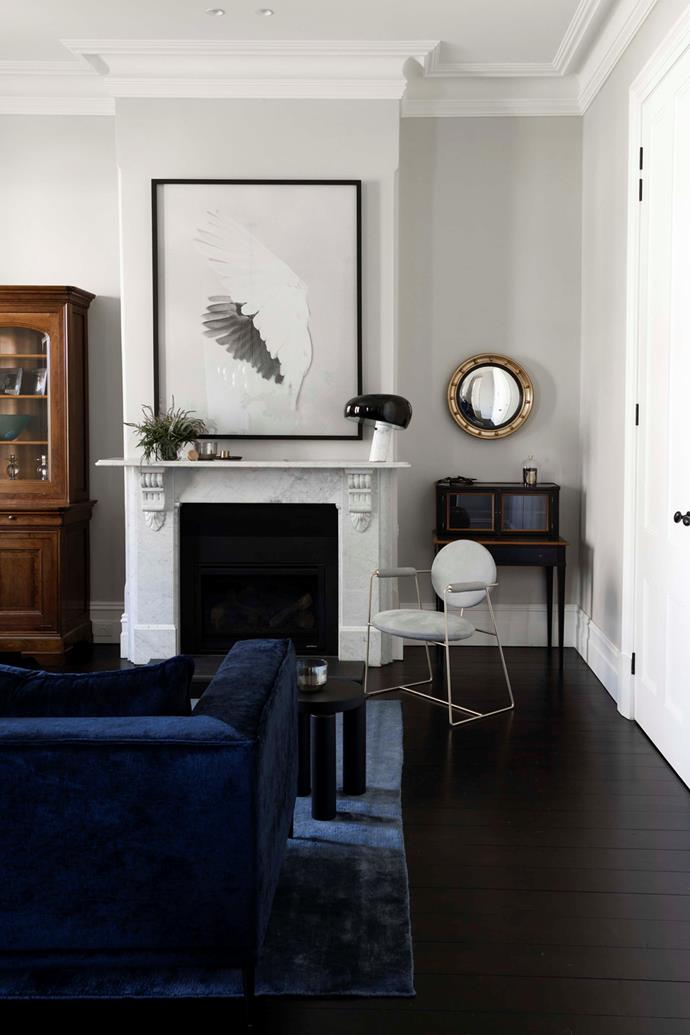 """""""Our formal rooms are so elegant and comfortable– we embrace any excuse to use them,"""" says homeowner Belinda.In the formal living room, an artwork entitled Cockatoo #16, Backyard Newcastle, NSW 2011 by Trent Park hangs over the mantelpiece."""
