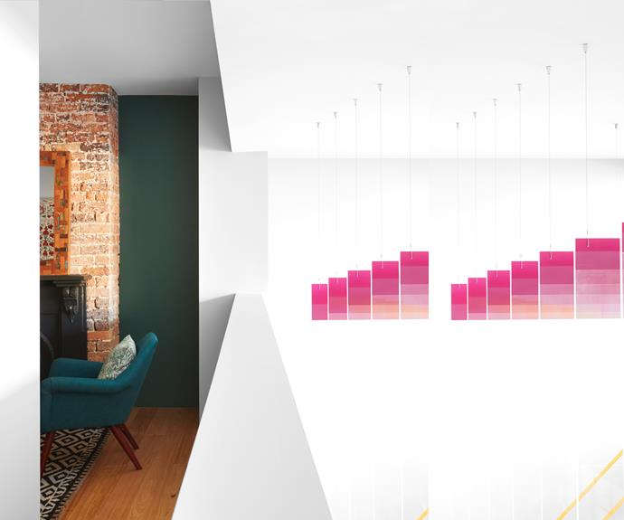 **HALLWAY** A perspex artwork by Laura Sutton creates a focal point from the upper living space.