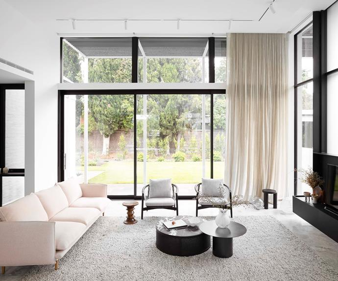 Contemporary living room with floor-to-ceiling windows and fireplace