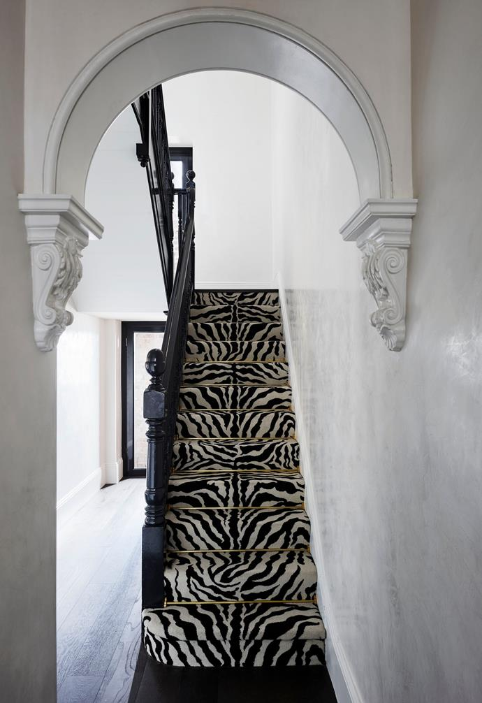 """The owner says the zebra-patterned carpet linking the four levels is """"totally unexpected and never fails to put a smile on my guests' faces when I greet them"""". Langhorne Carpet Company 'Zebra Loop' in Black/White from Premier Carpets."""