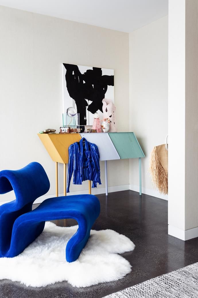 """A Rotonda table lamp by Adrian Cruz and sculptures by Kirsten Perry, Luke Ryan O'Connor and Bettina Willner are prized additions in Cheryl's bedroom. """"The What Was artwork is by a good friend of mine, Love Ludie, and is an homage to the early '90s,"""" Cheryl tells."""