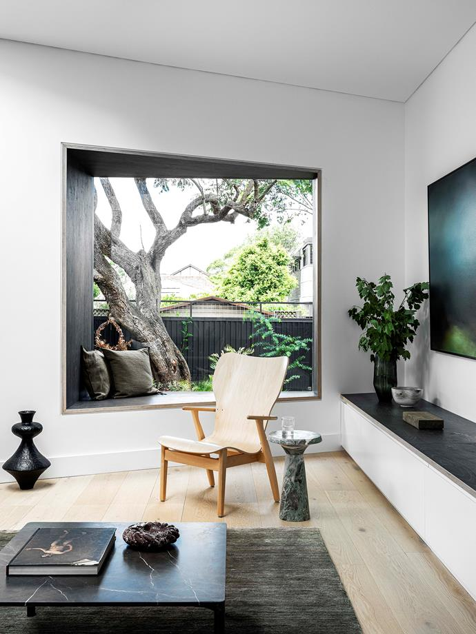 The 2x2-metre box window is positioned to frame the jacaranda tree outside and designed with an angled window seat so that the occupants feel connected to the garden.