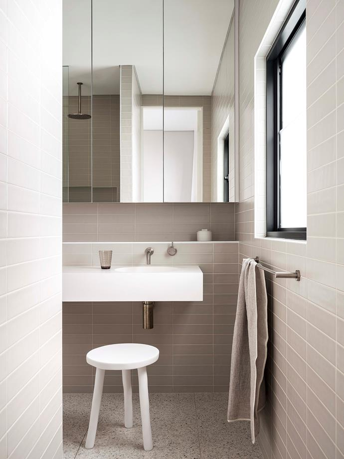 In the main ensuite, natural light, beautiful finishes and practicality were all part of the brief. Subway tiles in off-white reach up to the ceiling while a generous wall-hung vanity help to amplify the feeling of space.