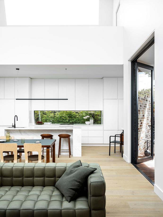 White light beaming in from the skylights above and oodles of built-in storage, the all-white kitchen is Maddy's vision of crisp, clean-lined perfection. The island is Elba marble from CDK Stone.