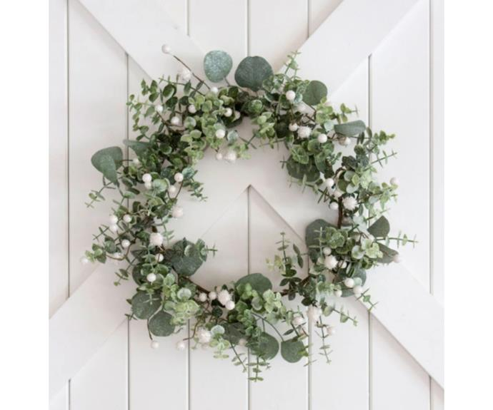"""**White Berry Christmas Wreath, $69, [Tara Dennis Store](https://www.taradennisstore.com/collections/christmas-decorations/products/christmas-wreath-white-berries target=""""_blank"""" rel=""""nofollow"""")**   A simple and stylish wreath to be dressed up with fairy lights or left as is. White berries and soft faux eucalyptus foliage so life-like, it brings the coastline to your front door, mantlepiece or Christmas table, dressed up with candles placed inside."""
